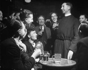 Priest-drinking-in-a-pub-during-a-revival-of-the-Church-of-England