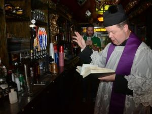 priest blesses beer